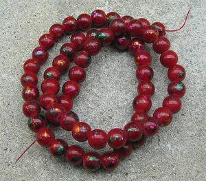 Glaspärlor 8mm röda med färgprickar