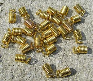 Hållare spiralavslut guld