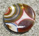Snäckskalscoin brun cirklar 30mm